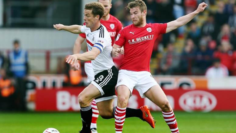 Scott Parker of Fulham and Sam Winnall of Barnsley during the Sky Bet Championship match between Barnsley and Fulham played at Oakwell Stadium, Barnsley on 15th October 2016